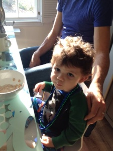deftly showcasing his spoon-handling skills and Mardi Gras beads